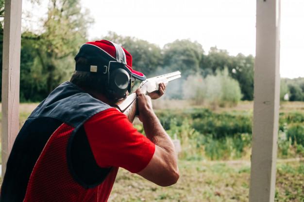 A beginner hunter practicing shooting in a shooting range