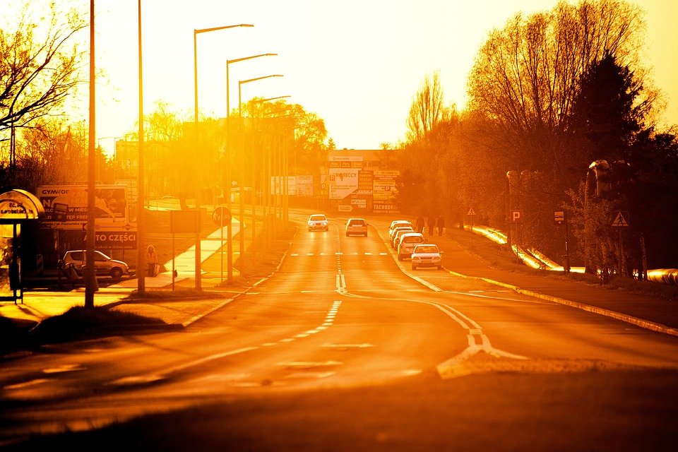 Scorching rays of sun on roadway, illustrating the concept of solar energy