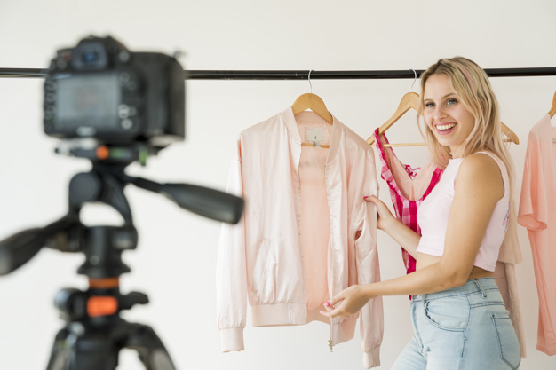 woman filming an explainer video for her apparel business