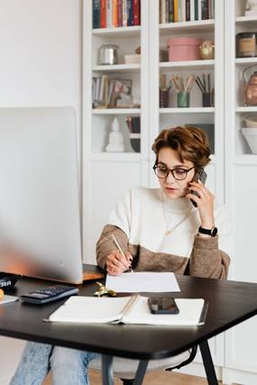 A businesswoman working on her desk.