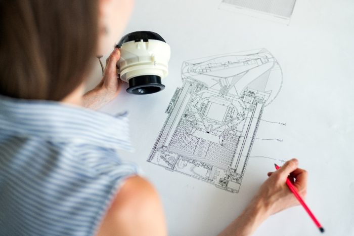 An engineer working on a design for a prototype