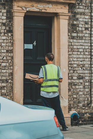 An Amazon delivery person on the door.