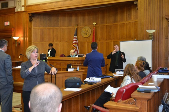 Woman In A Courtroom Conveying Information to Someone in ASL