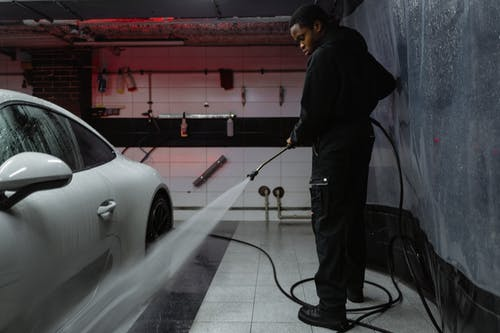 a car getting washed by a professional at a car detail shop