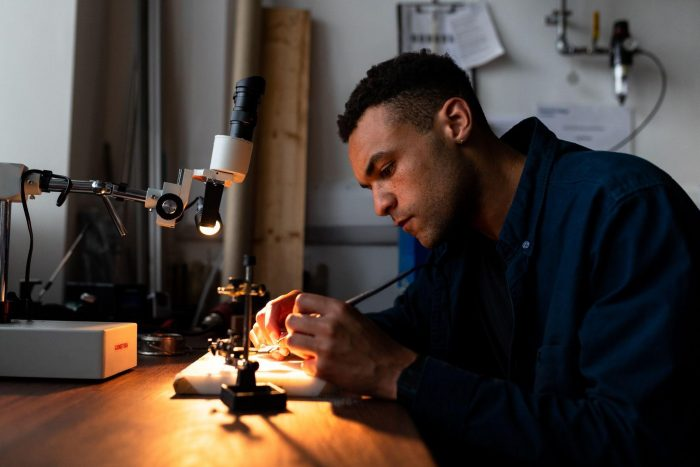 A mechanical engineer working on machines